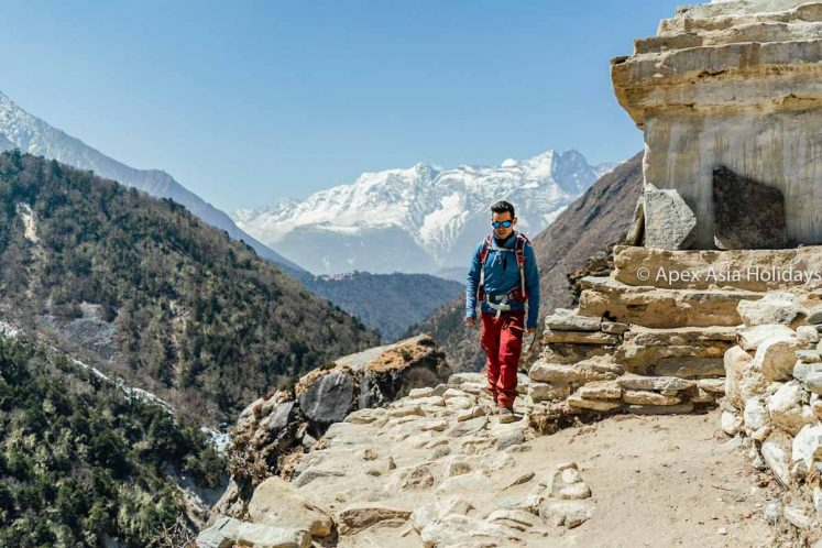 A handsome trekkers Jesse heading to Everest Base Camp the with Gokyo Valley Trek by Apex Asia Holidays
