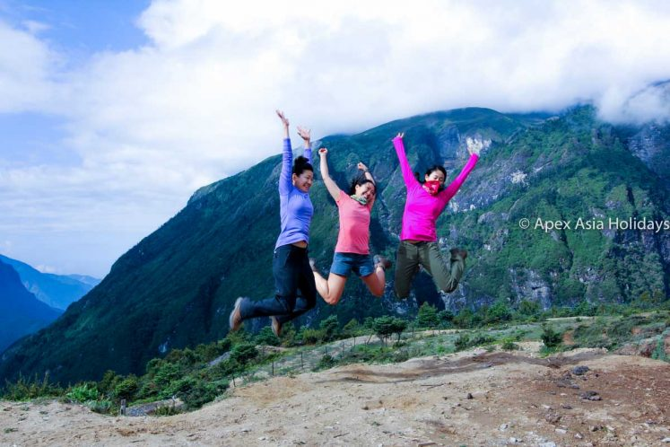 Trekkers are jumping at Namche Bazzar in Everest Trekking Region