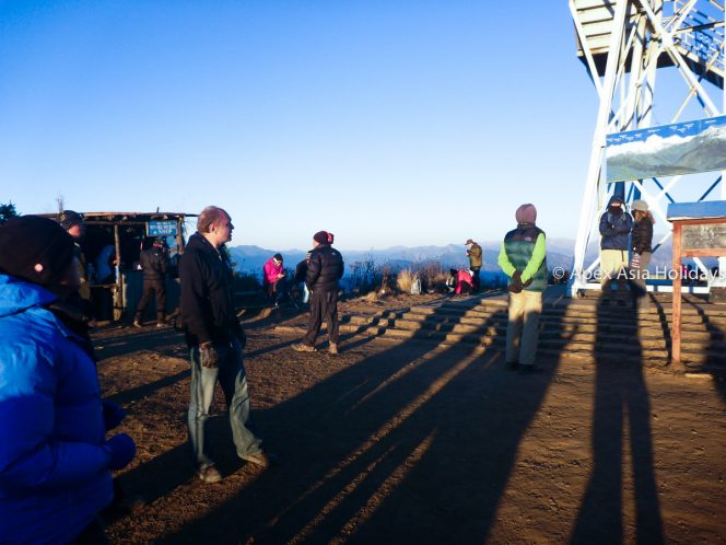 Trekkers are posing for photos at poon hill in Annapurna Trekking Region