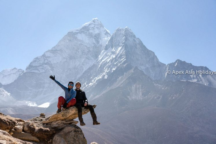 Trekkers are posing with Mountain in Everest Base Camp Trekking Everest Region