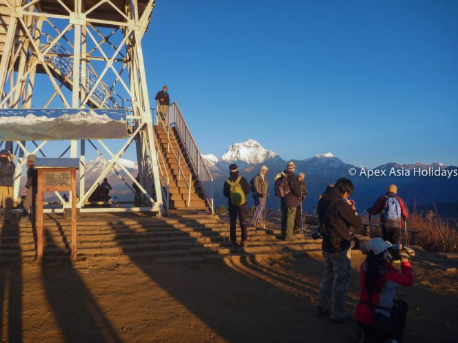 Trekkers are enjyoing stunning sunrise view from Poon Hill in Annapurna Trekking Region