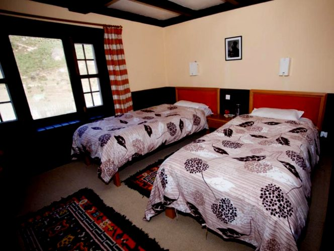 The bed room of Yeti Mountain Home in Namche. Everest Panorama Luxury Trek with Apex Asia Holidays